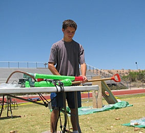 For the second year, Fountain Hills High School students set a Guiness World Record in Potato Launching. Here, Freshman Garrett Sweetland prepared for his record launch of 17 from his homemade launcher.
