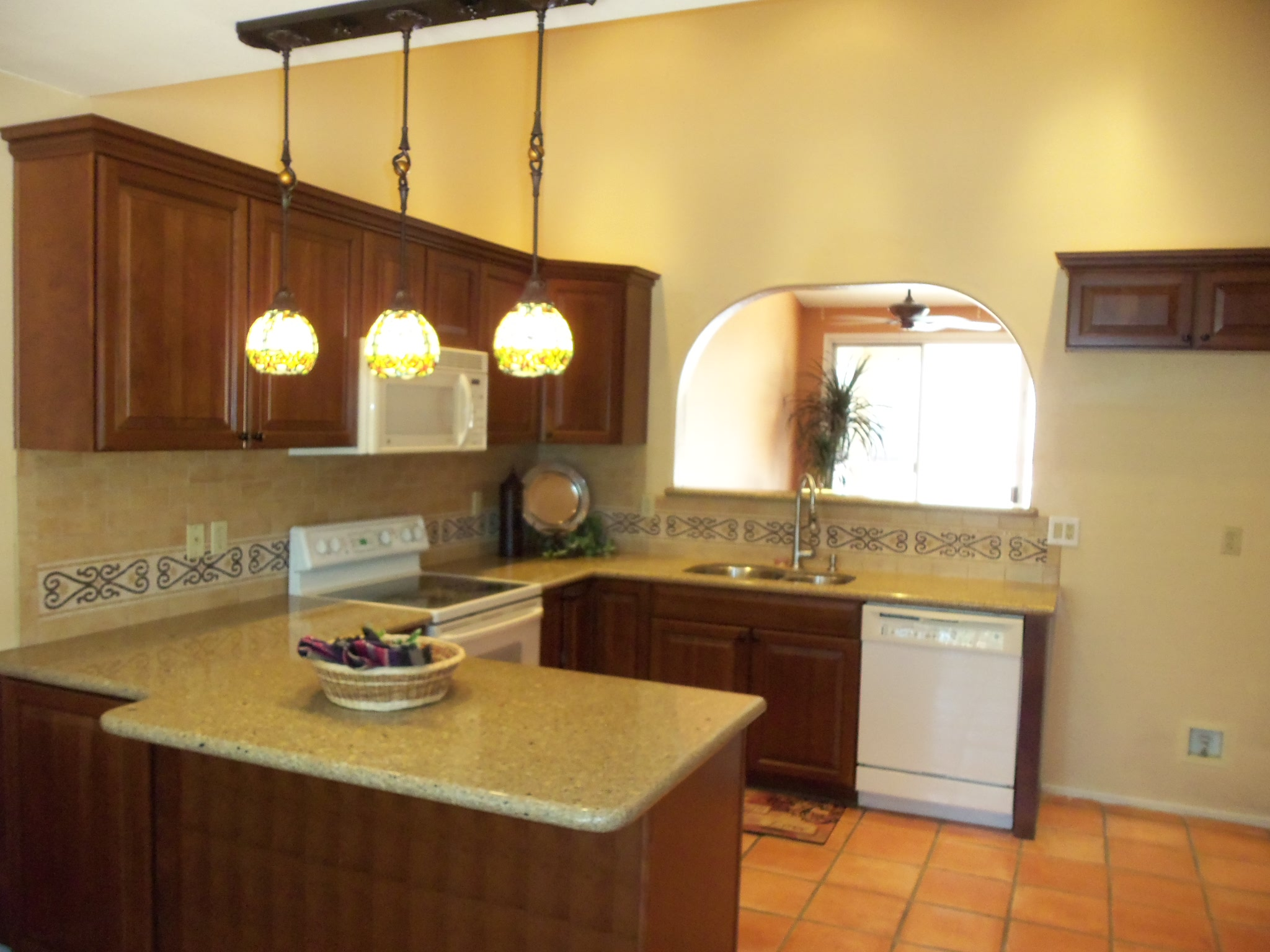 Spanish style 3 bedroom bank owned home under 200 000 in Bright kitchen