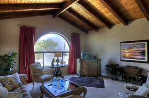 Living Room with Vaulted Wood and Beam Ceiling