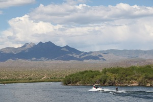 Waterskier with 4 Peaks in Background