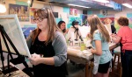 Carrie Schwanke of Carrie's Twisted Art, left, leads an art class Wednesday, Sept. 16, 2015, in her basement studio. Dave Wallis / The Forum